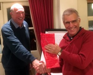 John Oram receiving his prize from Jo Bonello